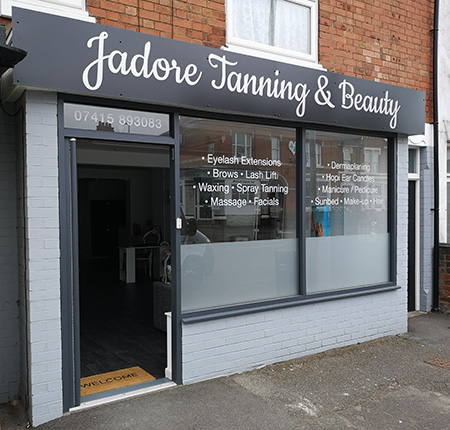 Jadore Tanning and Beauty salon fascia signage and frosted vinyl window graphics