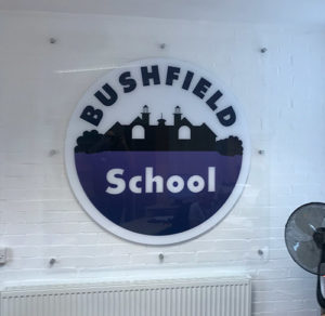 Acrylic logo sign fitted on a wall at a Junior School