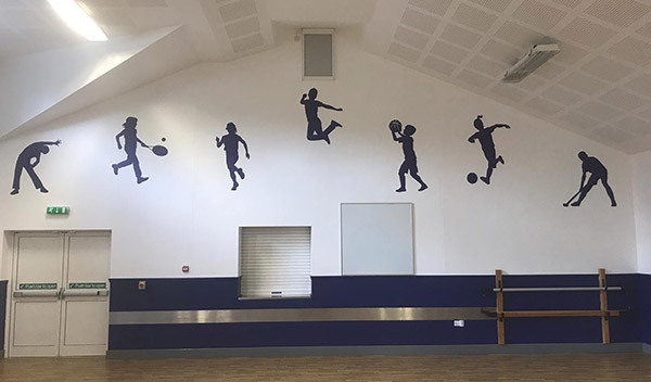 Wall silhouettes on a hall wall in a Primary School