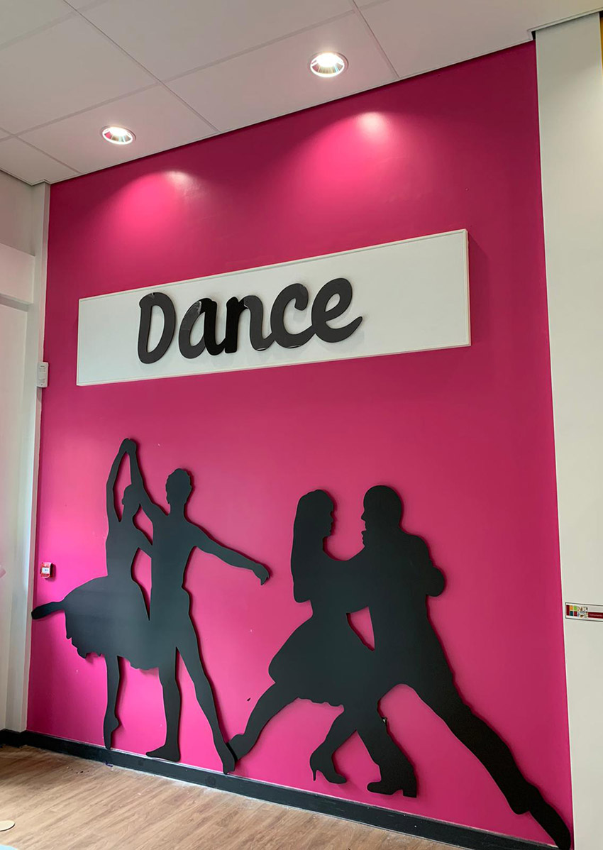 Silhouette wall signs of people dancing for a Primary School