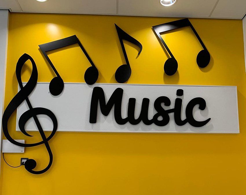 Silhouette wall signage of musical notes for a Primary School