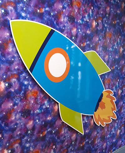 Rocket wall sign at a Junior school