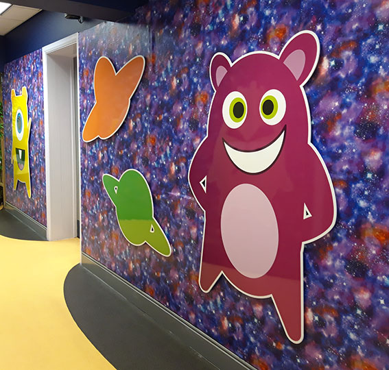 Dojo and space theme wall signs at a Junior school