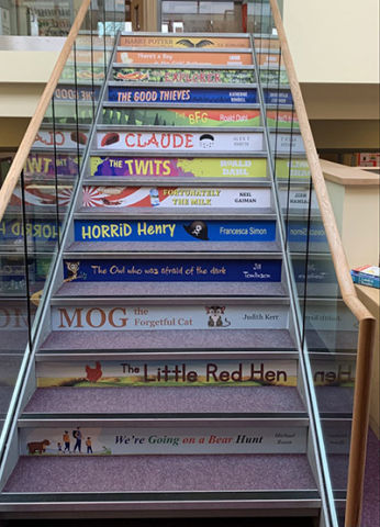 Book spine stair graphic signage for schools
