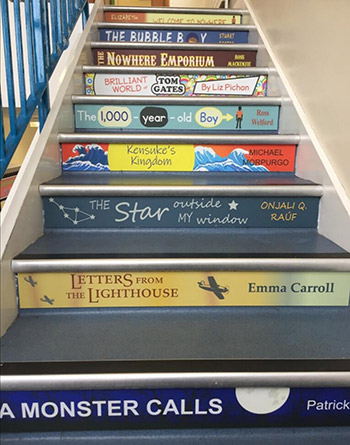 Book spine stair graphics for a Junior School