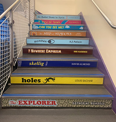Book spine stair graphics for a Primary School