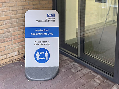 NHS South East London CCG vaccination centre services pavement stand sign