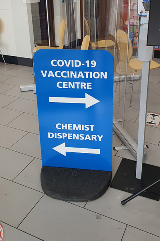 Vaccination Centre signage pavement sign stand directing patients around the site