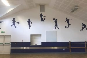 Silhouette wall graphic signage in a Primary School hall