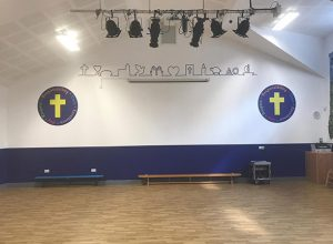 Wall graphic signage in a Primary School hall