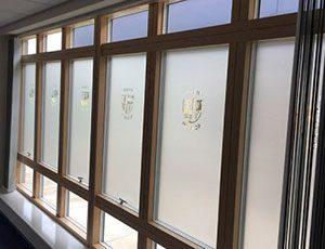 Frosted vinyl on windows in school corridor