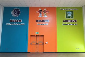School hall signage showing Academy Values